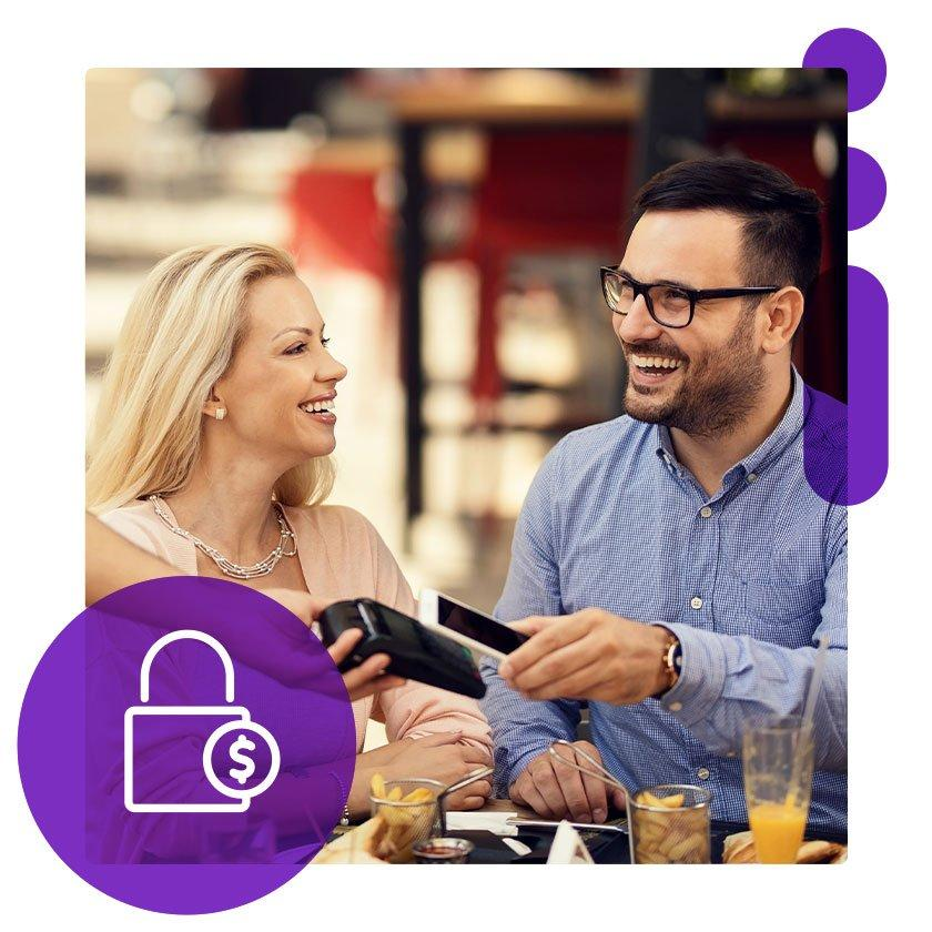 Couple paying lunch with phone